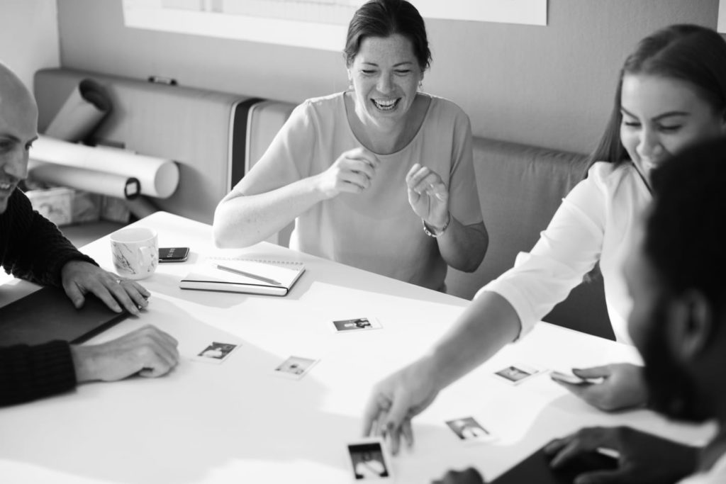 Employees happy brainstorming black and white