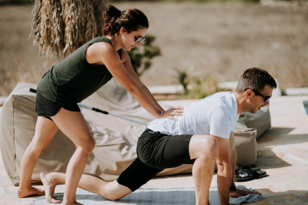man and woman exercising